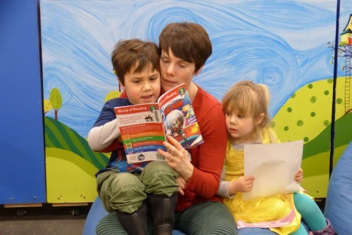 Family reads together in the Kid's Room