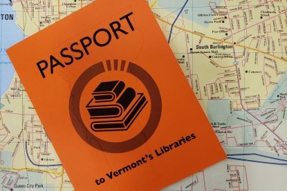 Library passport on top of Vermont Map