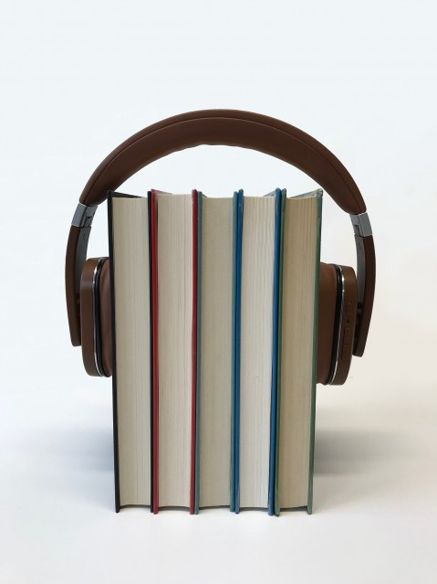Headphones hold books together.